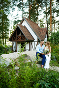 Just married people sitting on big stone in natural environment and talking