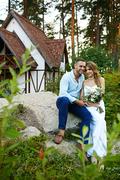 Happy bride and groom spending their honeymoon in special house in rural environment