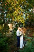 Amorous couple standing by rowan tree at sundown