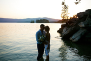 Young lovers standing in water at sunset