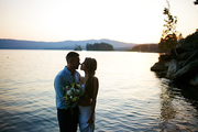 Just married young couple standing close to one another in lake