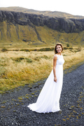 Happy young bride in white gown during honeymoon journey
