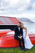 Bonding couple having rest by lake during travel