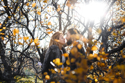 Amorous couple flirting among trees during adventurous journey