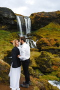 Young couple flirting on background of waterfall