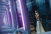 Happy bride and groom standing inside modern building