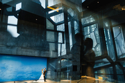 Young bride and groom standing inside luxurious modern building