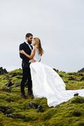 Newlyweds enjoying romantic time in natural environment