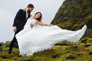 Bride and groom dancing in natural environment