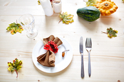 Thanksgiving symbols and decorations on wooden table served for feast