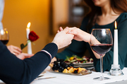 Hands of man and woman during romantic dinner