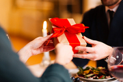 Amorous man giving present for Valentine day to his girlfriend