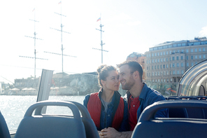 Young heterosexual couple enjoying summer cruise