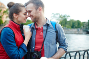 Young photographer and his girlfriend spending weekend by riverside