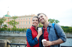 Affectionate travelers visiting place of interest during vacation