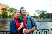 Cheerful couple spending time by riverside