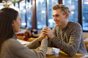 Affectionate couple spending holiday evening in cafe