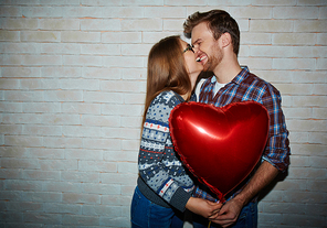 Flirty dates with red heart-shaped balloon expressing love and happiness