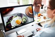 Food-designer editing images for food-advert