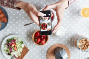 Smartphone touchscreen with shot of healthy food