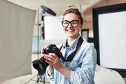 Happy photographer in modern photo-studio