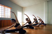 Four woman stretching together in dancing studio