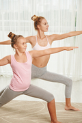 Mother and daughter training together at home