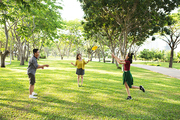 Group of friends playing frisbee in the park