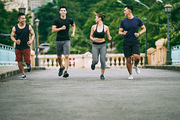 Happy Asian young people enjoying jogging in the morning