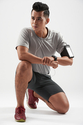 Studio shot of Asian young sportsman wearing earphones