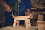 Cropped image of joiner making little wooden stool