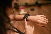Hands of woman checking pulse in application on her smart watch