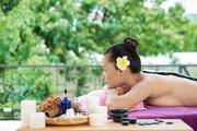 Woman enjoying stone therapy in spa resort