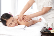 Young woman getting relaxing back massage with oils