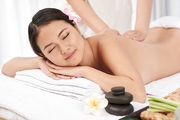 Young Asian woman smiling when getting back massage