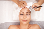 Smiling young woman getting oxygen therapy in beauty salon