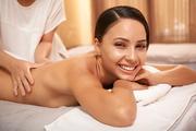 Gorgeous young woman enjoying massage in beauty salon