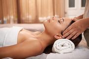 Beautiful young woman enjoying relaxing head massage