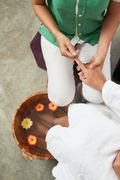 Woman having spa procedure for feet and hands, view from above