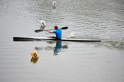 Athlete floating on canoe on a rowing competition