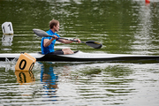 Young sportsman paddling to the finish in his kayak