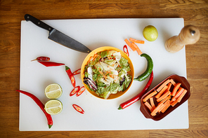 Above view background image of Asian food ingredients on cutting board in restaurant kitchen, copy space