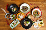 Top view composition of several Asian food dishes on wooden background, copy space