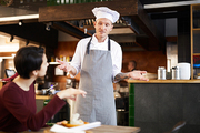 Portrait of professional chef apologizing to client in restaurant, copy space