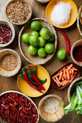 Above view background of various spices in wooden bowls on table, copy space