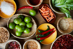 Top view background of various spices in wooden bowls on table, copy space