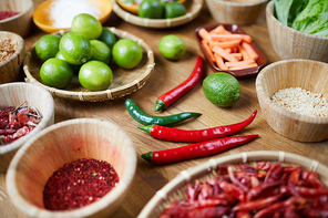 Closeup background of various spices in wooden bowls on table, copy space