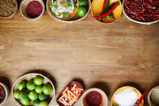 Food background of various spices standing on wooden table, copy space