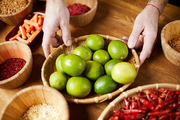 Close up of unrecognizable man holding lime bowl while cooking spicy food, copy space