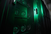 Close-up of ventilation cabinets with devices for mining crypto currency in dark green room, copy space